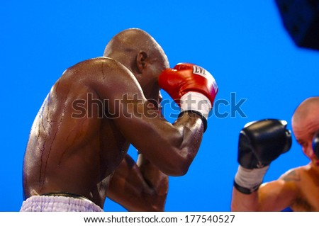 MILAN, ITALY-AUGUST 28, 2006: Boxer men fighting during a professional Boxing Championship. - stock photo