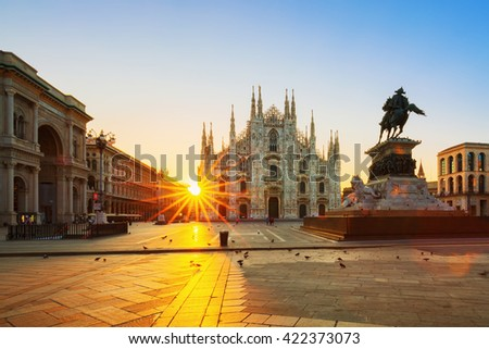 MILAN ITALY-AUGUST-30-2015:The Duomo cathedral at sunrise.The Gothic cathedral took nearly six centuries to complete. It is the fifth largest cathedral in the world and the largest in italy - stock photo