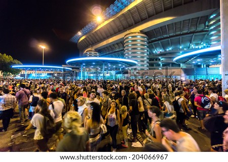 MILAN, ITALY - CIRCA july 2014: Crowd of people outside San Siro football stadium. Stadium is the home of the teams Milan and Inter. - stock photo