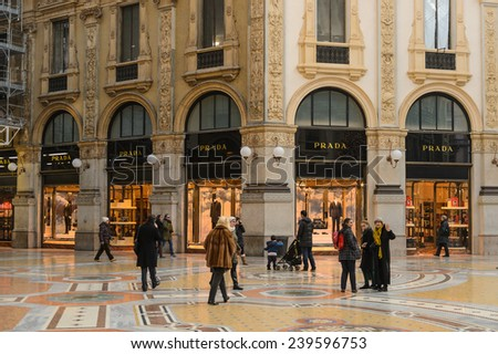 MILAN, ITALY - DEC 23, 2014: Prada boutique in Galleria Vittorio Emanuele II, one of the world's oldest shopping malls. The gallery is built between 1865 and 1877 by Giuseppe Mengoni - stock photo