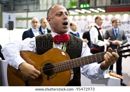 MILAN, ITALY - FEBRUARY 17: A performer sings  dressing in a traditional sicilian outfit at BIT International Tourism Exchange on february 17, 2012 in Milan, Italy. - stock photo