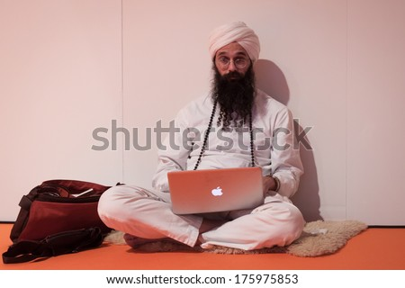 portrait of an old indian man on a natural background