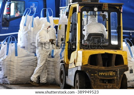 Milan, Italy - February 2016: men at work in a center of asbestos storage - stock photo