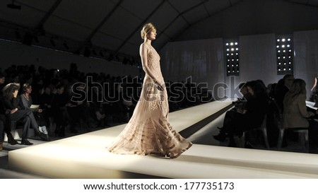 MILAN, ITALY-FEBRUARY 26, 2010: Model on runway catwalk during the spring-summer fashion collection of italian stylist Alberta Ferretti. - stock photo