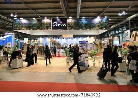 MILAN, ITALY - FEBRUARY 17: People at Siria tourism pavilion during BIT, International Tourism Exchange Exhibition on February 17, 2011 in Milan, Italy. - stock photo