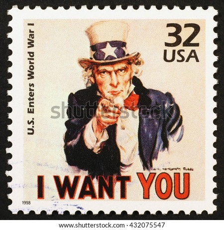 "Milan, Italy - January 08, 2014: american postage stamp reproducing a famous poster to recruit soldiers for World War I: Uncle Sam who says ""I want YOU"" - stock photo"