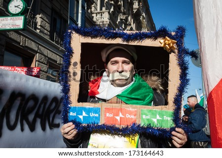 MILAN, ITALY - JANUARY 25: Demonstrators of the so-called December 9 movement march in the city streets to protest against government and political class on JANUARY 25, 2013 in Milan.  - stock photo