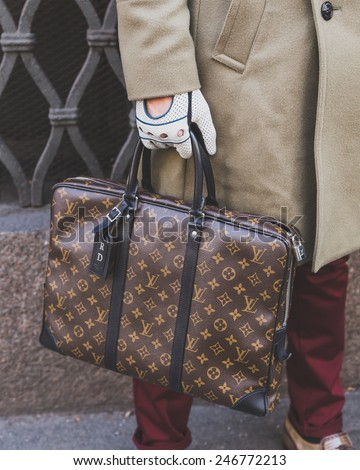 MILAN, ITALY - JANUARY 20: Detail of a Louis Vuitton bag outside Cavalli fashion show building for Milan Men's Fashion Week on JANUARY 20, 2015 in Milan. - stock photo