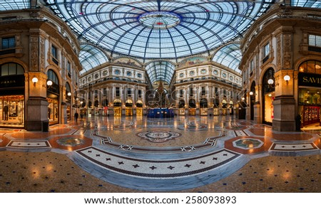 MILAN, ITALY - JANUARY 2, 2015:  Galleria Vittorio Emanuele II in Milan. It's one of the world's oldest shopping malls, designed and built by Giuseppe Mengoni between 1865 and 1877. - stock photo