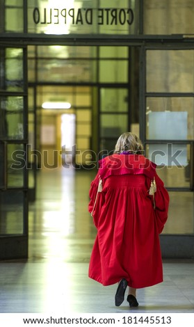 MILAN, ITALY-JANUARY, 28, 2012: Judge wearing a red toga, during the Opening Ceremony of the Justice Year, at the court of law, in Milan. - stock photo