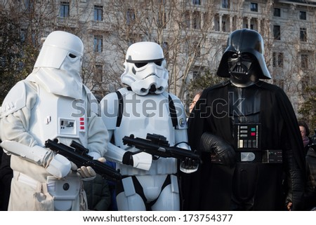 MILAN, ITALY - JANUARY 26: People of 501st Legion, official costuming organization, take part in the Star Wars Parade wearing perfectly accurate costumes on JANUARY 26, 2013 in Milan. - stock photo
