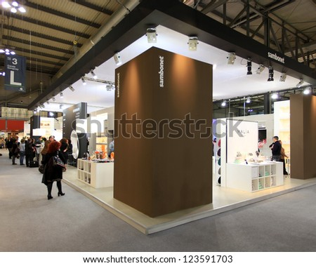 MILAN, ITALY - JANUARY 28: People visit design and interior decoration products stand at Macef, International Home Show Exhibition on January 28, 2011 in Milan, Italy. - stock photo
