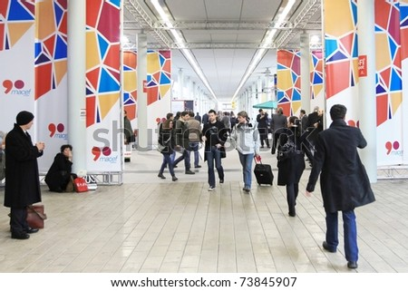 MILAN, ITALY - JANUARY 28: People visit stands looking for design and interior decoration products at Macef, International Home Show Exhibition January 28, 2011 in Milan, Italy. - stock photo