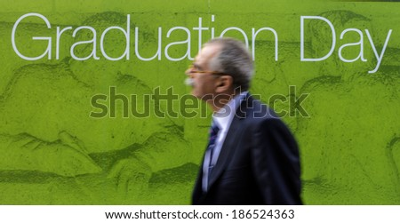 MILAN, ITALY-JANUARY 12, 2012: Relative of a student arrives at the Bocconi University, for the graduation day, in Milan. - stock photo
