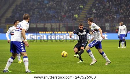 MILAN, ITALY-JANUARY 21, 2015: soccer player lukas podolski ikicks the ball at the san siro stadium for the serie A match FC Internazionale vs Sampdoria, in Milan. - stock photo