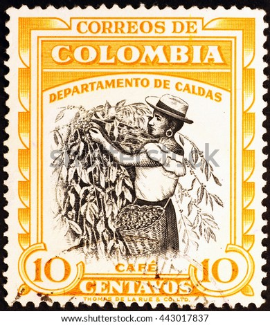 Milan, Italy - July 30, 2015: Coffee picker on vintage colombian postage stamp - stock photo