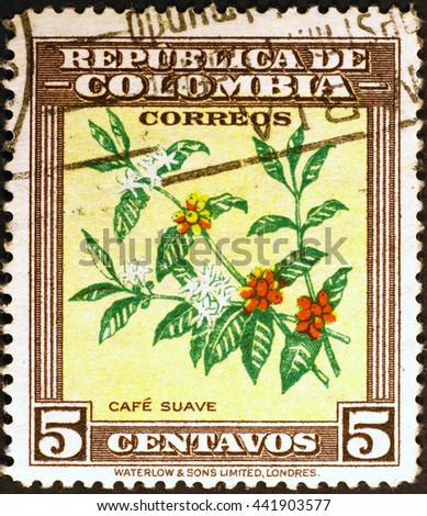 Milan, Italy - July 30, 2015: Plant of coffee on colombian postage stamp - stock photo