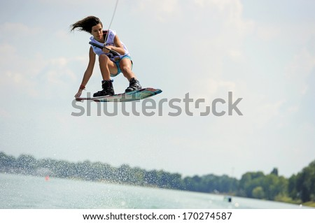 MILAN, ITALY - JULY 14: World Wakeboard Championship at the Idroscalo lake in Milan July 14, 2011.Victoria de Armas (ARG) during the Junior Women Quarter Finals. - stock photo