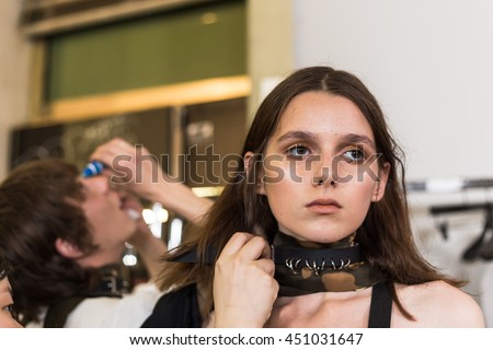 MILAN, ITALY - JUNE 19: Beautiful model poses in the backstage just before Damir Doma SS 17 show during Milan Men's Fashion Week on JUNE 19, 2016 in Milan. - stock photo
