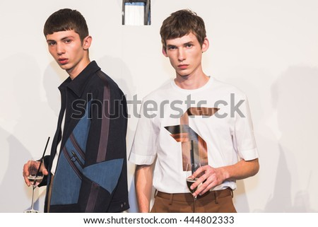 MILAN, ITALY - JUNE 18: Beautiful models pose in the backstage just before Neil Barrett SS 17 show during Milan Men's Fashion Week on JUNE 18, 2016 in Milan. - stock photo