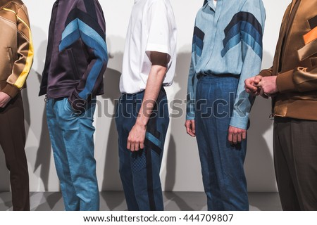 MILAN, ITALY - JUNE 18: Detail of models posing in the backstage just before Neil Barrett SS 17 show during Milan Men's Fashion Week on JUNE 18, 2016 in Milan. - stock photo