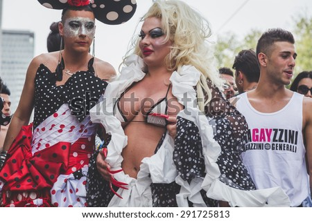 MILAN, ITALY - JUNE 27: People at gay pride parade in Milan JUNE 27, 2015. Thousands of people march in the city streets for the annual gay pride parade, claiming equality and legal rights. - stock photo
