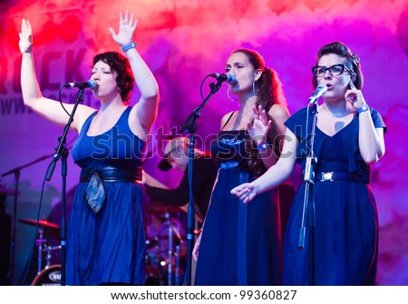 MILAN, ITALY - JUNE 11: Three female vocalist of Ghemon + Soul Combo Band perform live on stage during Mi Ami music festival in Milan on June 11, 2011 - stock photo