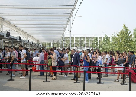 MILAN, ITALY-JUNE 05, 2015: visitors waiting in line to enter at EXPO 2015, in Milan. - stock photo