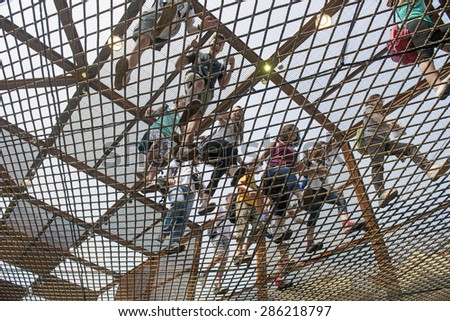 MILAN, ITALY-JUNE 05, 2015: visitors walking on the Brazil pavillion elastic rubber pavement at EXPO 2015, in Milan. - stock photo