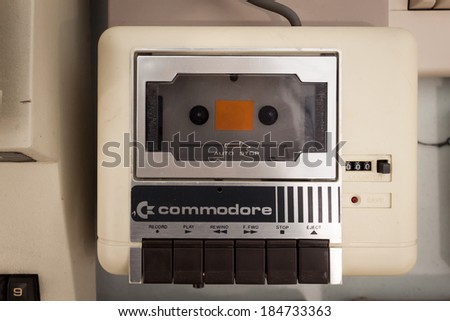 MILAN, ITALY - MARCH 30: Commodore cassette player on display at Robot and Makers Milano Show, event dedicated to robotics and makers on MARCH 30, 2014 in Milan. - stock photo