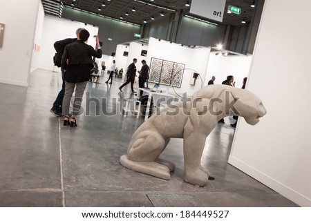MILAN, ITALY - MARCH 28: People visit Miart, international exhibition of modern and contemporary art on MARCH 28, 2014 in Milan. - stock photo