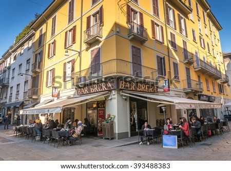 MILAN, ITALY - MARCH 18, 2016 : Unidentified people are sitting out side bar, close to famous Brera Gallery. - stock photo