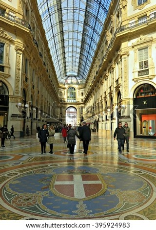 MILAN, ITALY - MARCH 01, 2016: View inside the Galleria Vittorio Emanuele II, which is one of the world's oldest shopping malls, housed within a four-story double arcade in central Milan. - stock photo