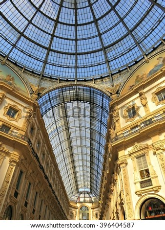 MILAN, ITALY - MARCH 01, 2016: View of the glass dome at Galleria Vittorio Emanuele II, which is one of the world's oldest shopping malls, housed within a four-story double arcade in central Milan. - stock photo