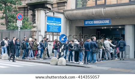 MILAN, ITALY - MAY 2, 2016: An immigration office in the centre of Milan. Europe is gripped by a migration crisis as many refugees have fled war and poverty in North Africa and the Middle East - stock photo