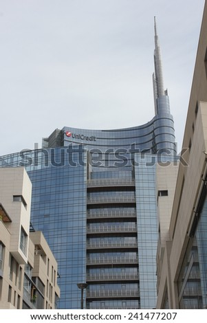 MILAN, ITALY - MAY 10 2014: Architectural detail of the glass facade on the Unicredit tower building in Milan, the tallest skyscraper in Italy - stock photo