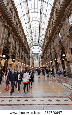 MILAN, ITALY - MAY 7, 2014 : Buyer in trade Galleria Vittorio Emanuele II in Milan. It's one of the world's oldest shopping malls, designed and built by Giuseppe Mengoni between 1865 and 1877 - stock photo
