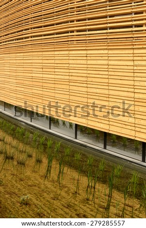 MILAN, ITALY - May 7: detail of wood facade of Ireland Pavilion with rice plants in foreground, shot  on may 7 2015  Milan, Italy  - stock photo