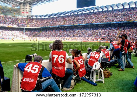 MILAN, ITALY - MAY 16: Sports photographers working during an Italian Serie A soccer match at San Siro stadium in Milan May 16, 2006. - stock photo