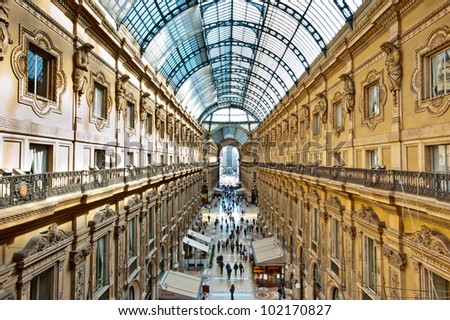 MILAN, ITALY - MAY 2: Unique elevated view of Galleria Vittorio Emanuele II seen from above in Milan on May 2, 2012. Built in 1875 this gallery is one of the most popular landmarks in Milan. - stock photo