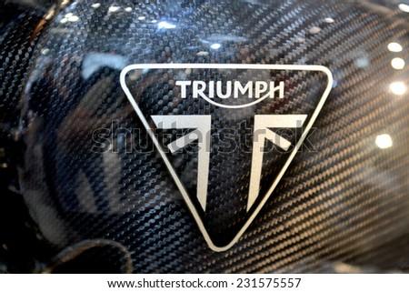 MILAN, ITALY - NOV 8:  Brand Triumph at EICMA, 72 th International Motorcycle Exhibition November 8, 2014 in Milan, Italy.  - stock photo