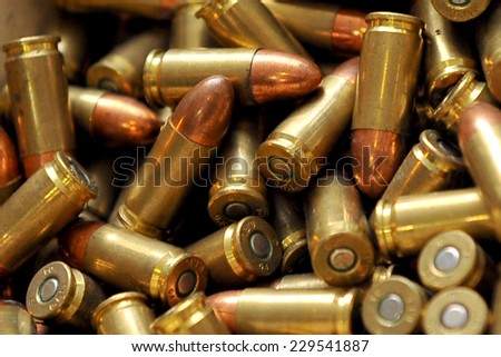 MILAN, ITALY - NOV 1: Bullets, Exhibitor sitting in his stand at Militalia, exhibition dedicated to militaria collectors and military associations on November 1, 2014 in Milan. - stock photo