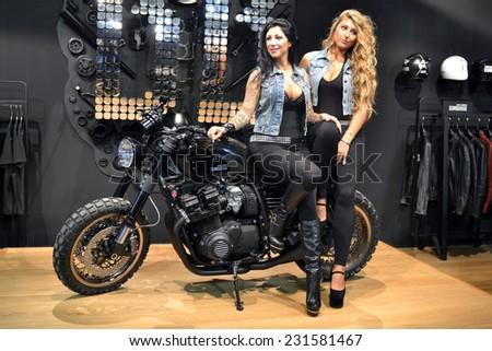 MILAN, ITALY - NOV 8: Model at EICMA, 72 th International Motorcycle Exhibition November 8, 2014 in Milan, Italy. - stock photo