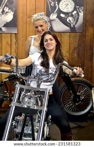 MILAN, ITALY - NOV 8: Models  at EICMA, 72 th International Motorcycle Exhibition November 8, 2014 in Milan, Italy. - stock photo