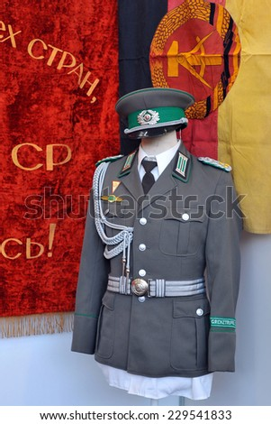 MILAN, ITALY - NOV 1: Russian uniform, Exhibitor sitting in his stand at Militalia, exhibition dedicated to militaria collectors and military associations on November 1, 2014 in Milan. - stock photo