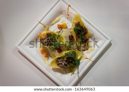 MILAN, ITALY - NOVEMBER 18: Chef creation with pasta at Golosaria, important event dedicated to culture and tradition of quality food and wine on NOVEMBER 18, 2013 in Milan. - stock photo