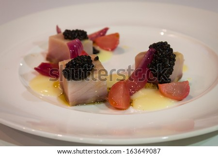 MILAN, ITALY - NOVEMBER 18: Raw tuna and caviar interpreted by chef at Golosaria, important event dedicated to culture and tradition of quality food and wine on NOVEMBER 18, 2013 in Milan. - stock photo