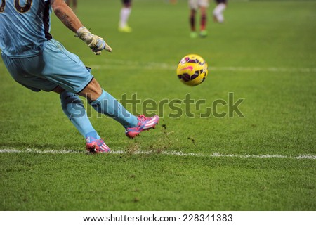 MILAN, ITALY-NOVEMBER 02, 2014: soccer goalkeeper kicks the ball during the italian serie A soccer match AC Milan vs Palermo, at the san siro stadium, in Milan. - stock photo