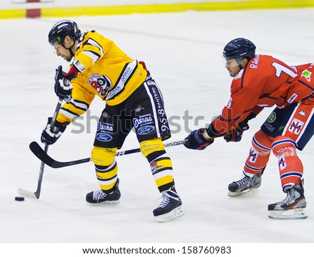 MILAN, ITALY - OCT 10: A. Silva and M.Ranallo of HC Milano during a game against the Valpellice at  Agora Arena on October 10, 2013, in Milan, Italy. - stock photo