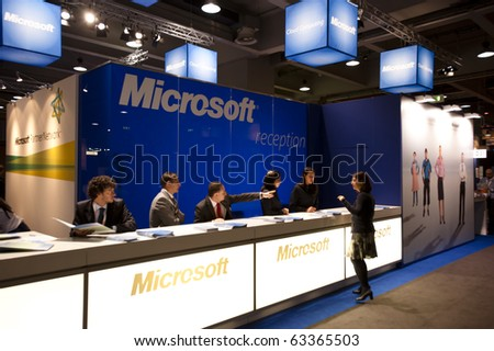 MILAN, ITALY - OCT. 20: Microsoft reception desk during SMAU, International Exhibition of Information and Communication Technology on October 20, 2010 in Milan, Italy. - stock photo